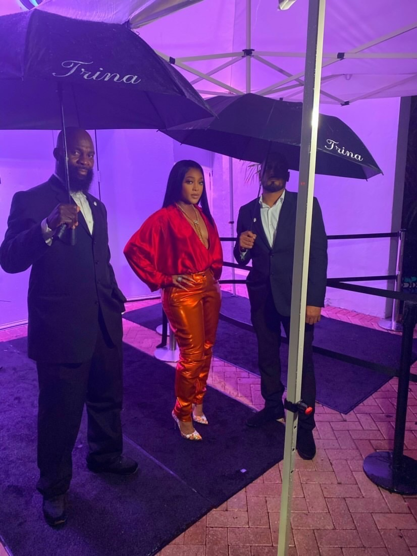 Who Wore it Better? Trina Slays Verzuz Battle in the Same Red and Orange Laquan Smith Spring 2021 Look Previously Worn by Kylie Jenner